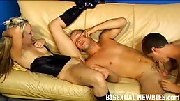 Bisexual guys are having a threesome with a hot, blonde lady and sucking each other's dick