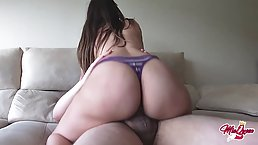 Big butt brunette is riding her roommate's dick on the couch, in front of a hidden camera